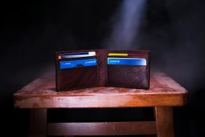Picture of a wallet with cards Debit Card vs Credit Card Protections for Scam and Fraud